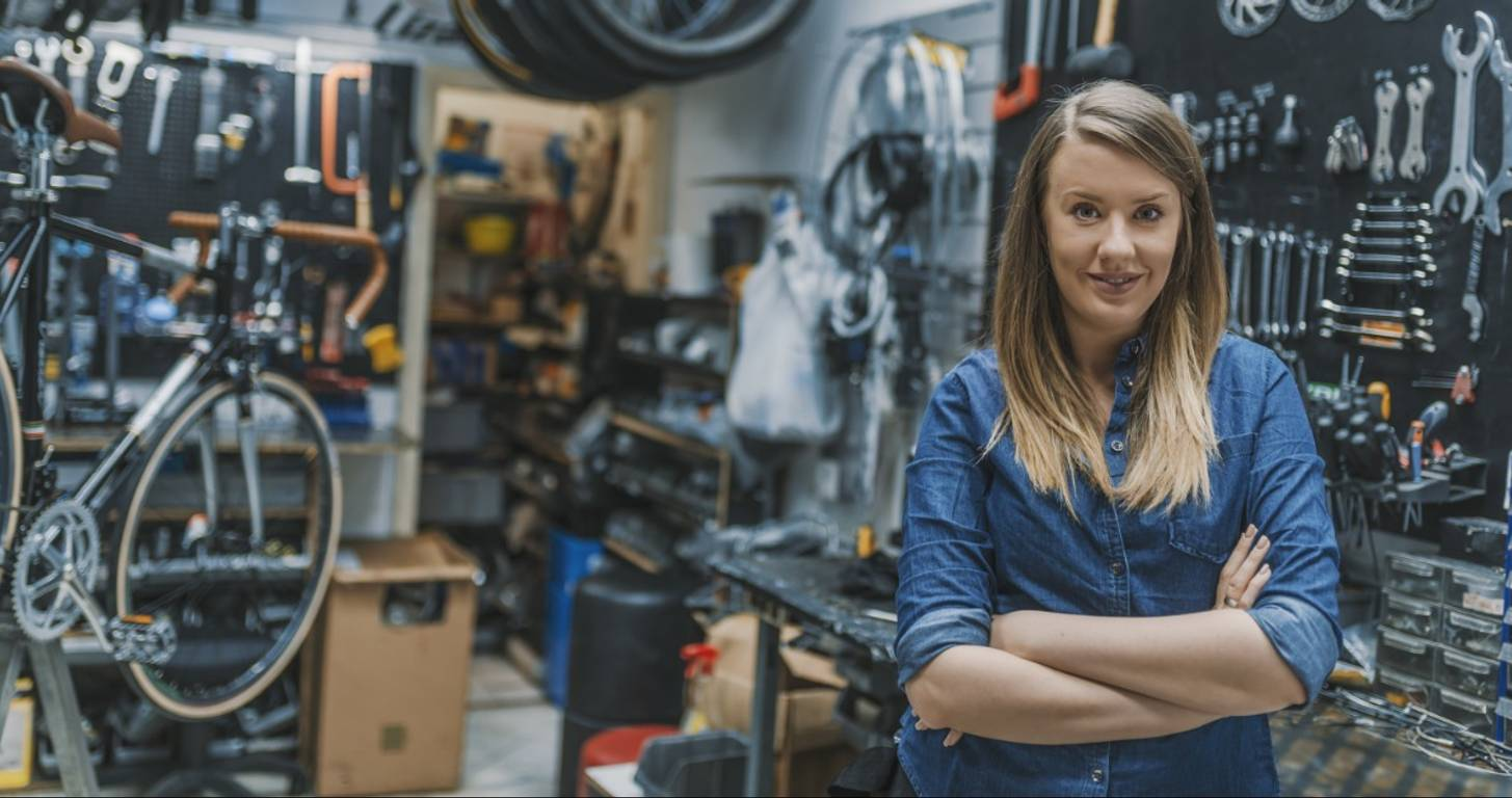 Female business owner standing in her bike shop