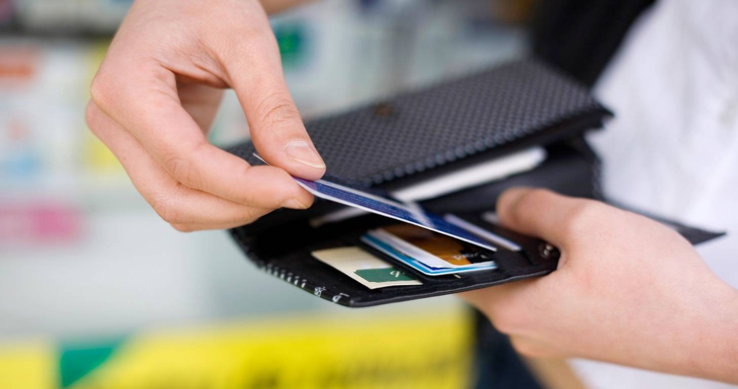 Man with several credit cards in his wallet