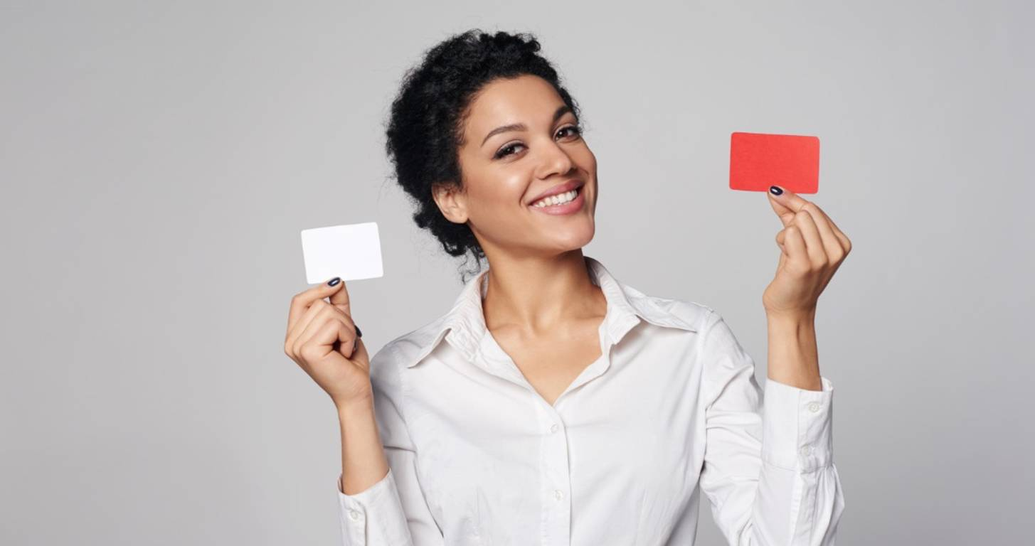 A woman holding two credit cards
