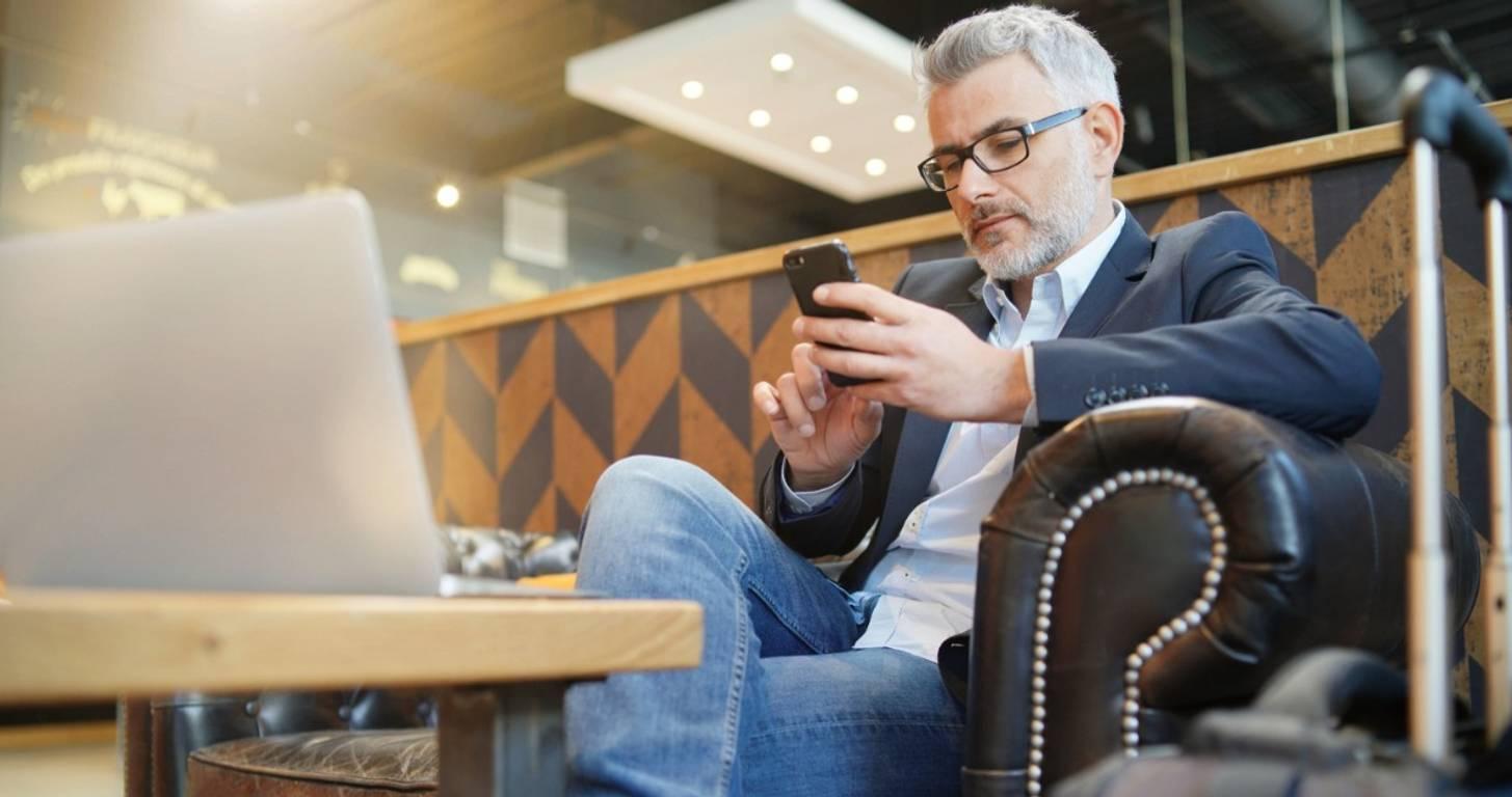 Man sitting an airport lounge