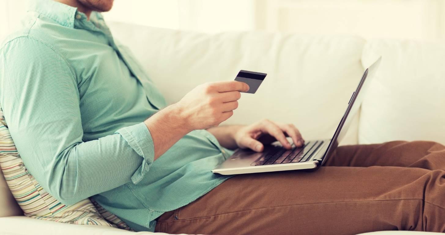 Man stacking credit card rewards on his laptop