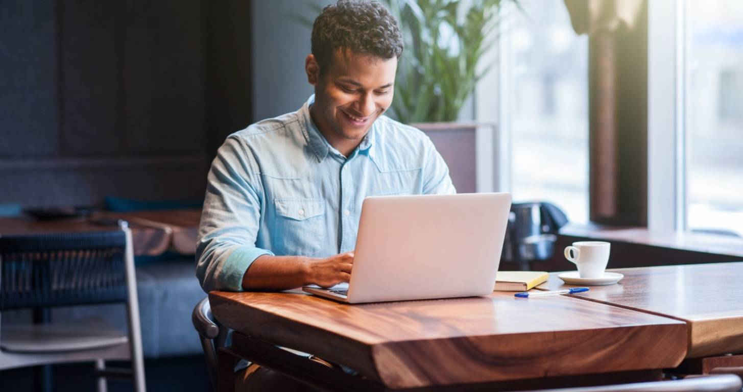 Man on laptop looking for small personal loans