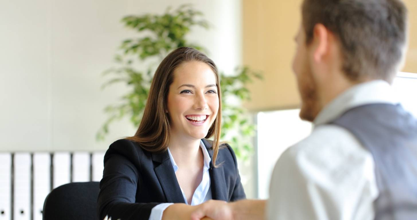 Woman shaking hands with man at office