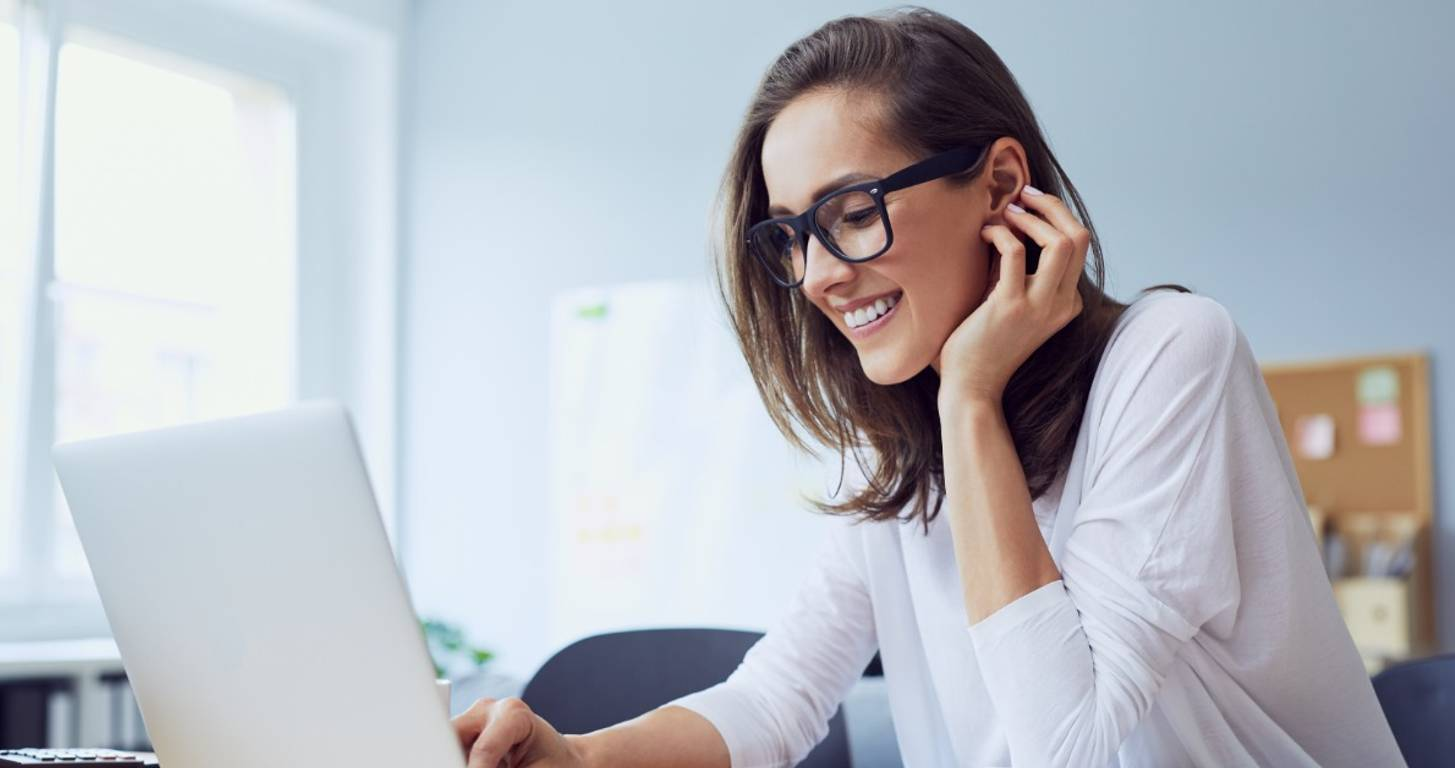 Woman with glasses using laptop