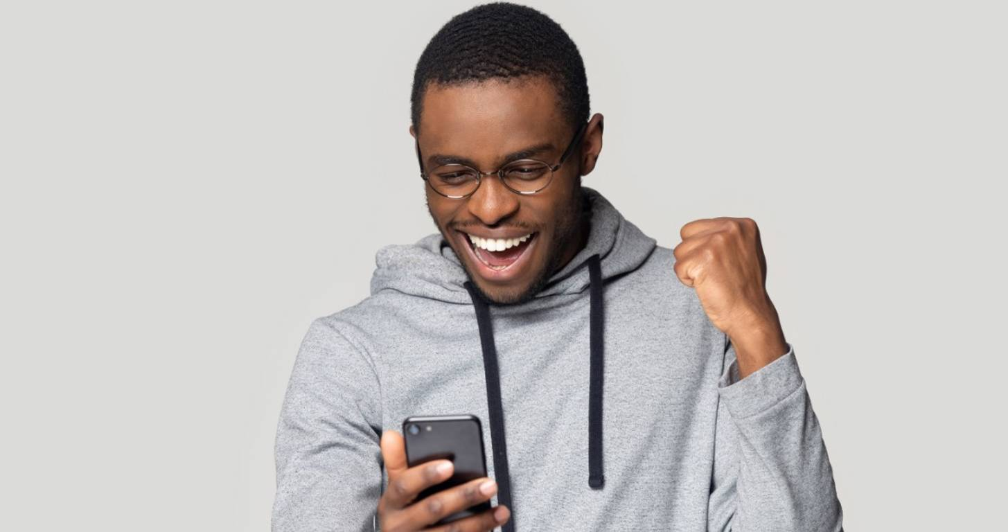 Smiling man looking at smartphone