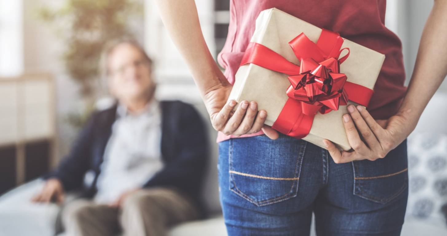 Woman hiding gift behind her back