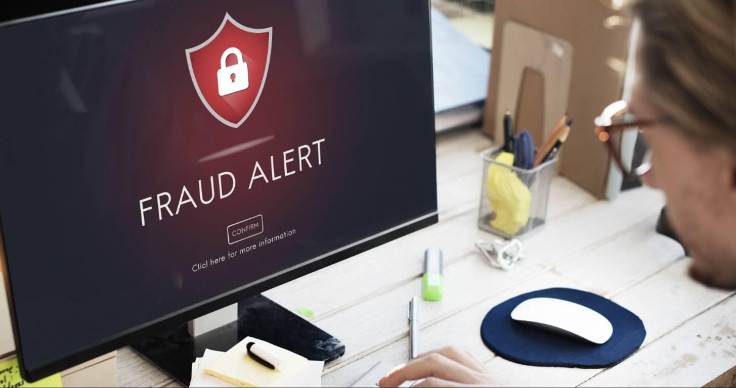 Fraud alert on desktop computer