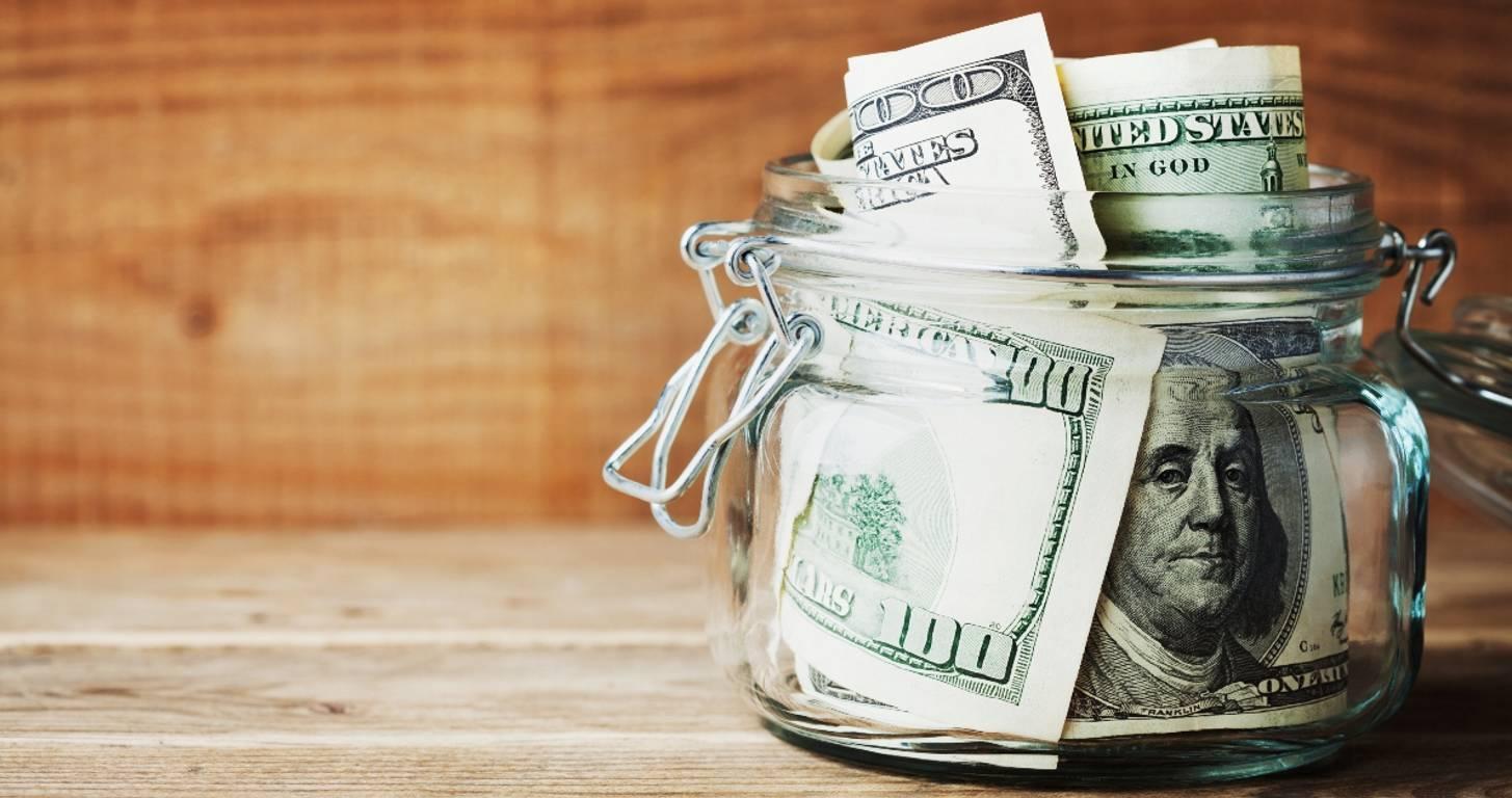 US money stuffed in jar