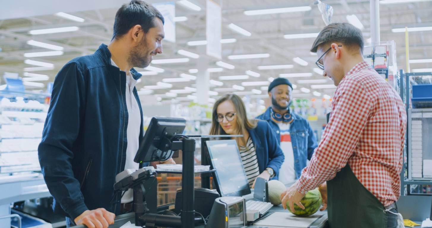 Grocery store employee with health insurance