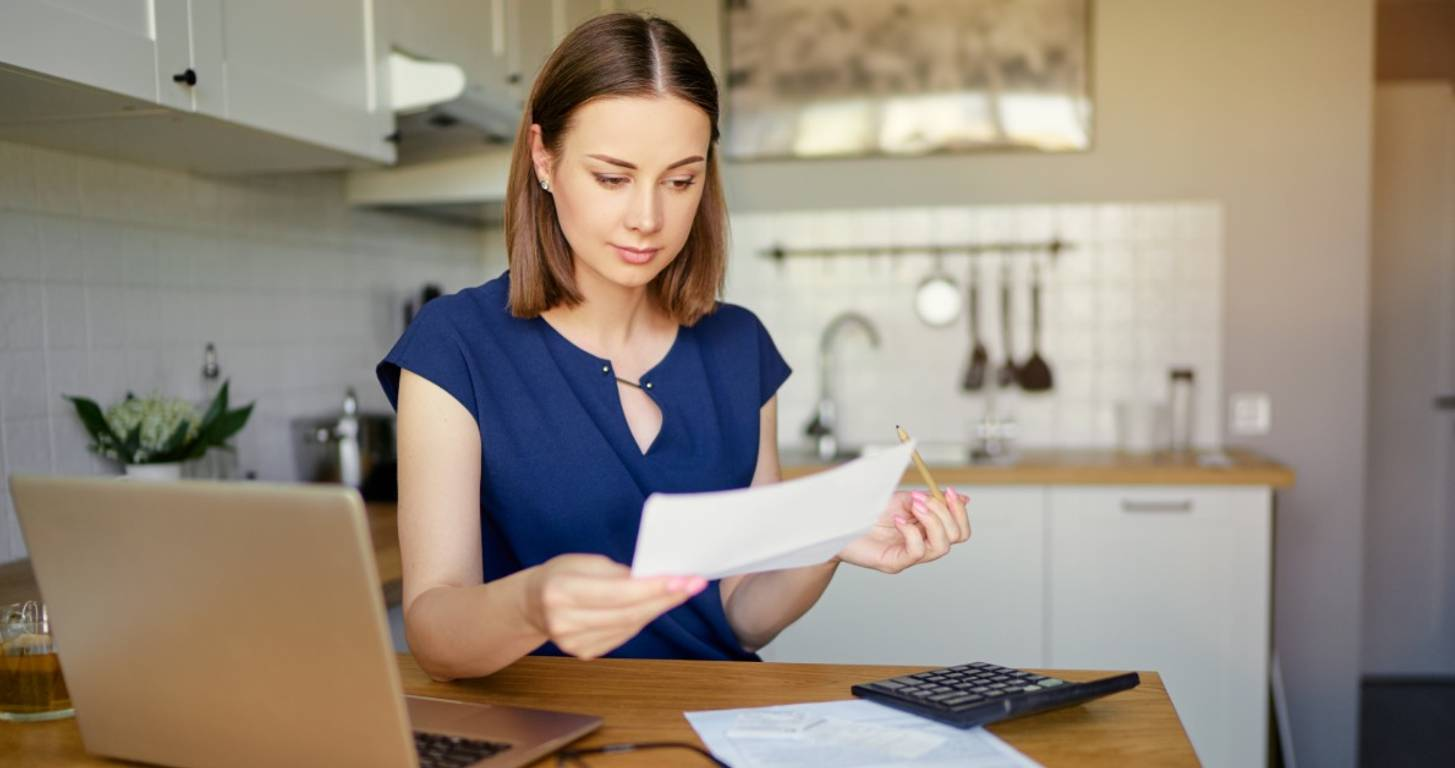 Woman looking at paperwork on table