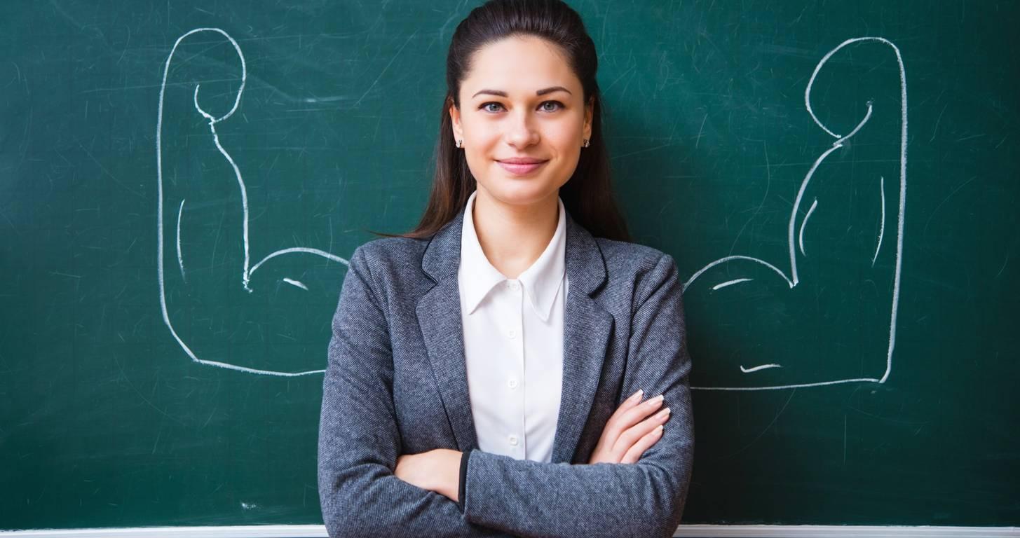 Teacher standing in front of chalkboard