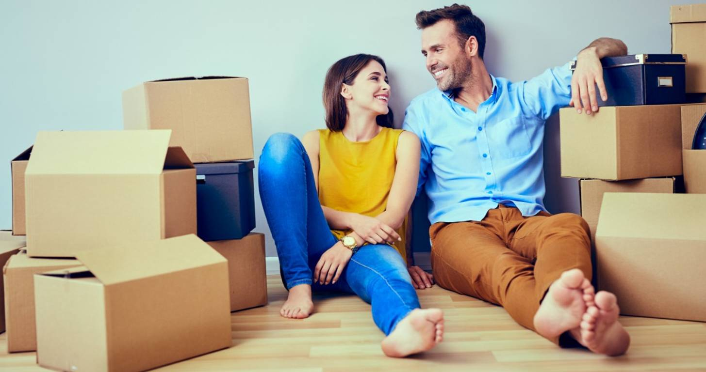 Smiling couple surrounded by boxes
