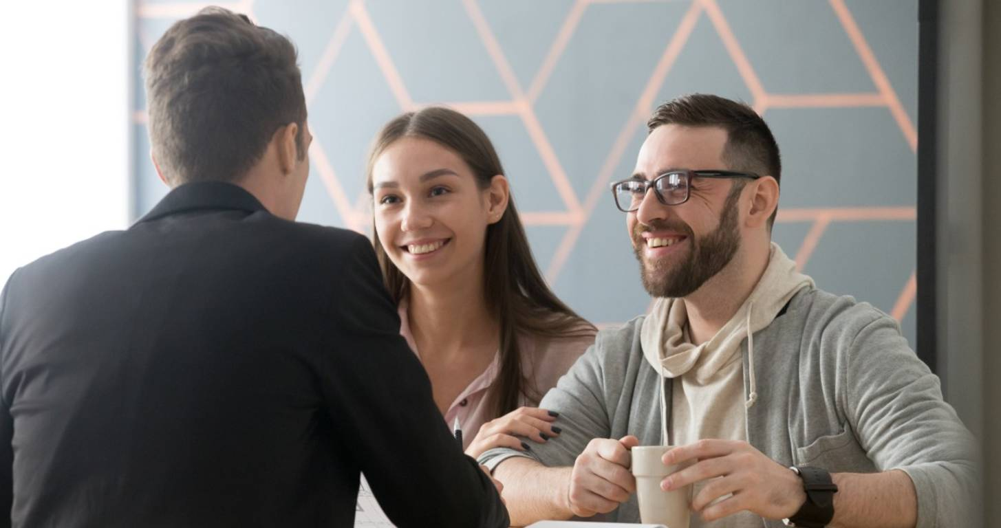Couple speaking with a lender