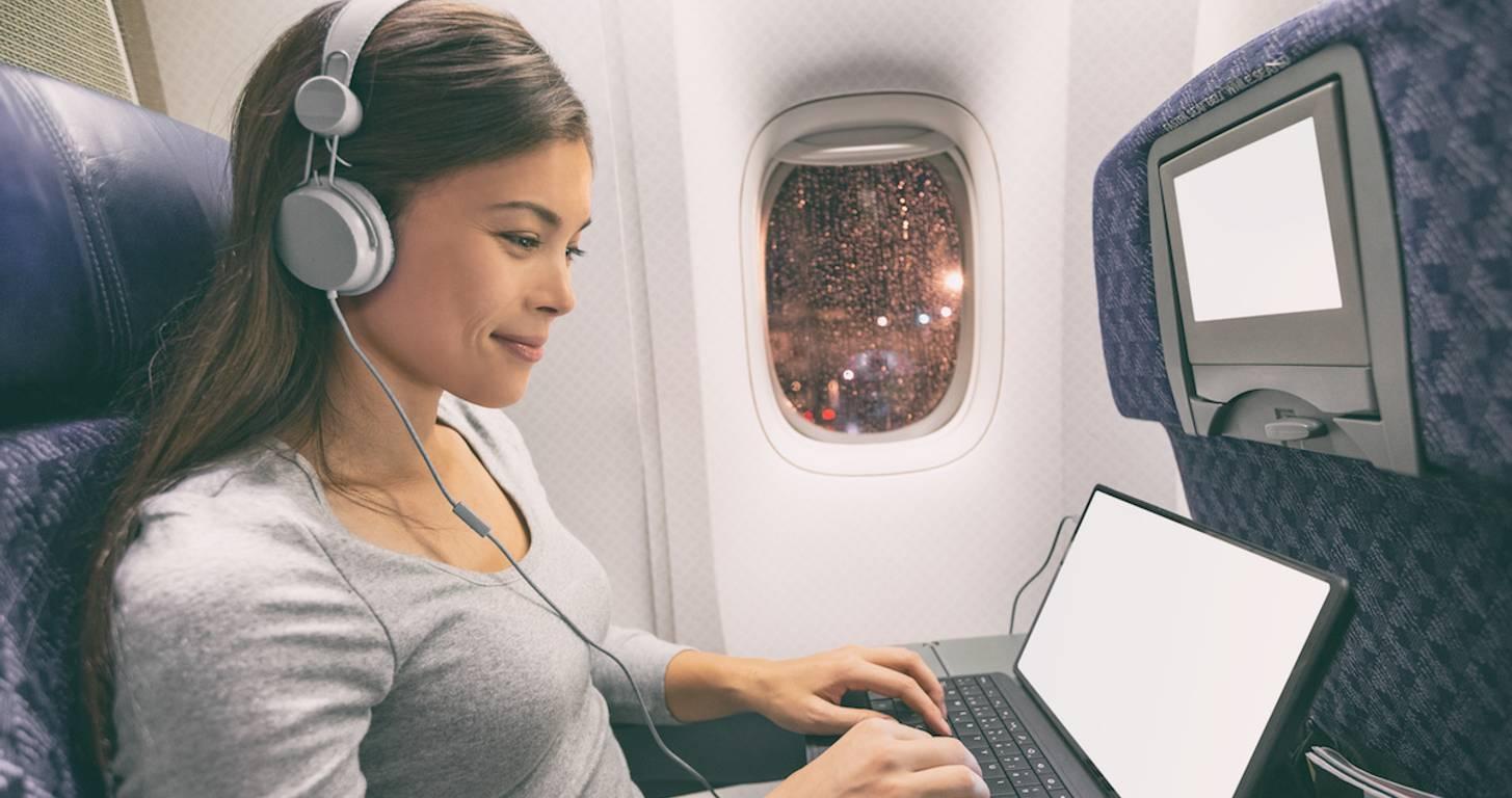 Woman using laptop on plane