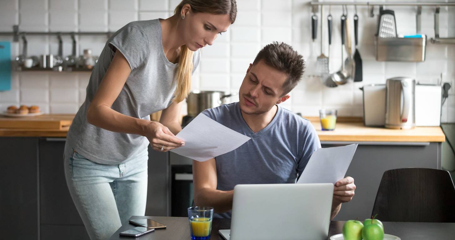 Serious couple looking at finances