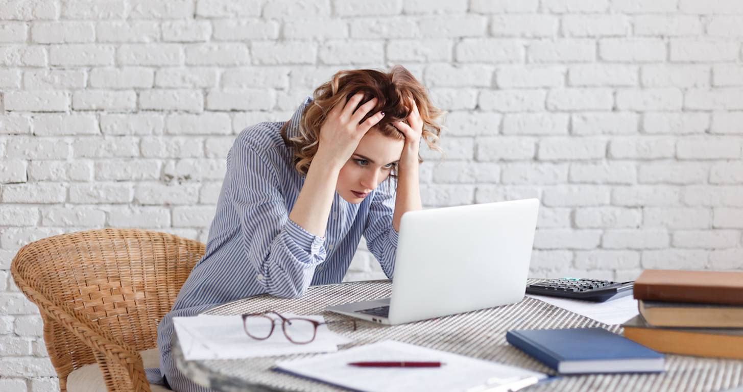 Sad woman using laptop