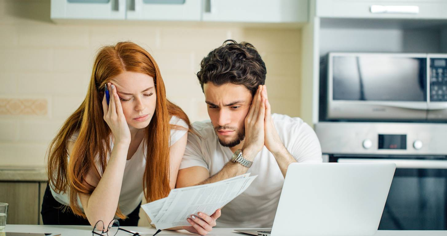 Worried couple paying bills