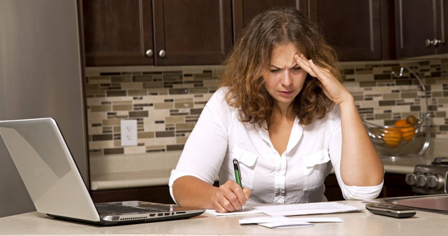 woman stressed paying bills