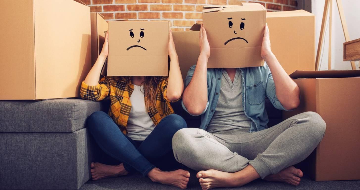unhappy couple moving