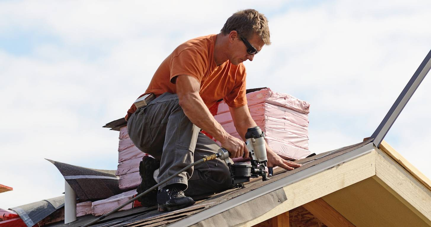 Man roofing
