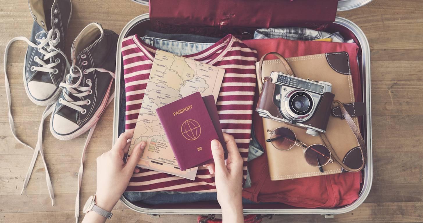 Traveler packing suitcase