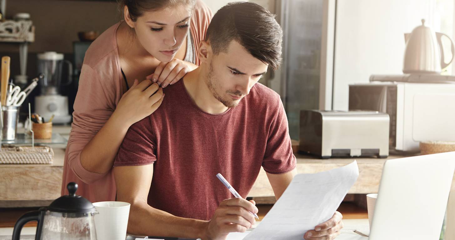 Concerned couple looking at finances