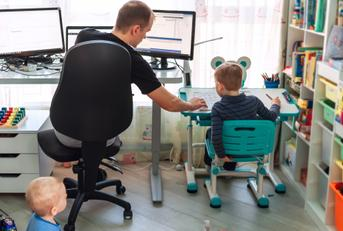 father working from home with kids