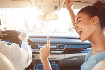 woman cheering in car