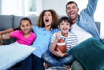 family watching super bowl on tv