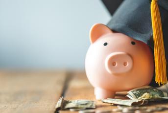 Piggy bank wearing graduation cap