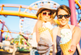 Two women at amusement park, eating ice cream