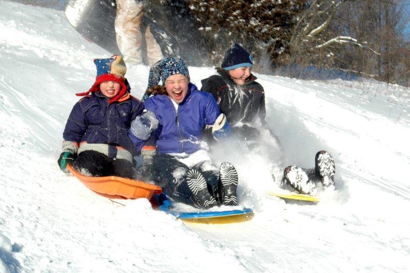 Children sledding in the winter