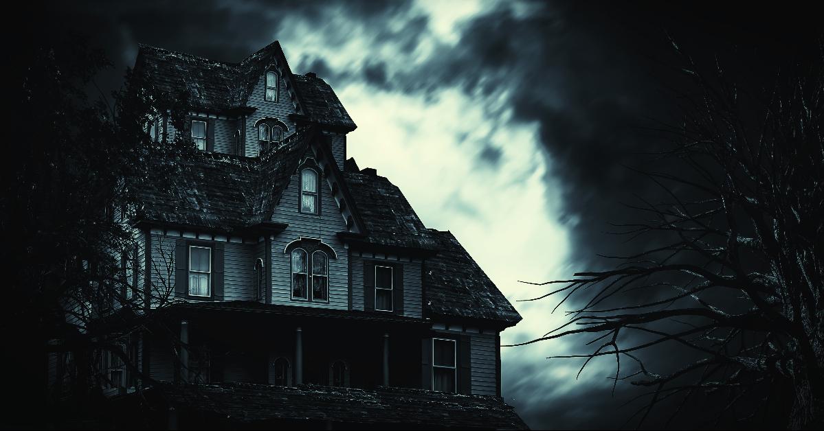 Spooky house under a stormy sky