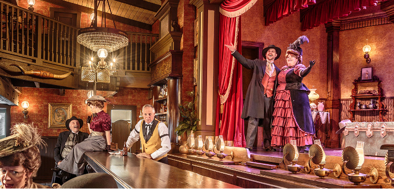 Two people on stage in the Calico Saloon at Knott's Berry Farm