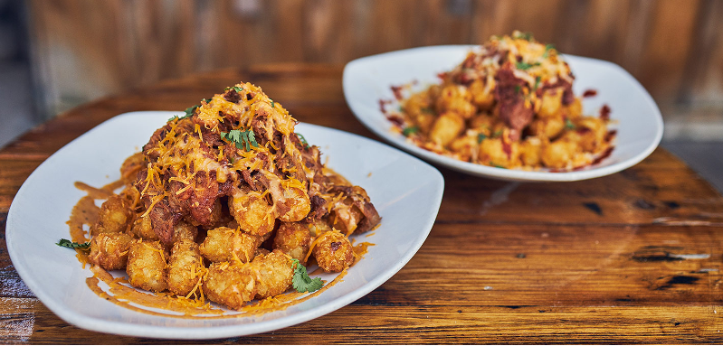 A plate of loaded tater tots from Calico Tater Bites at Knott's Berry Farm