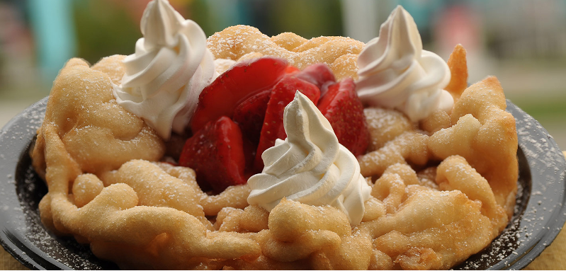 A funnel cake with ice cream and strawberries from Log Ride Funnel Cake at Knott's Berry Farm