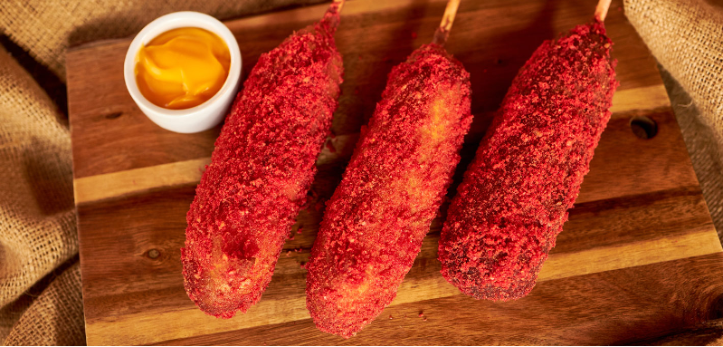 Three spicy corndogs from Strictly-on-a-Stick at Knott's Berry Farm